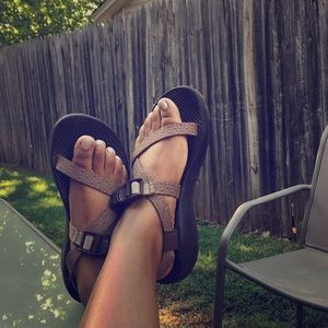 Brown and tan single strap chacos